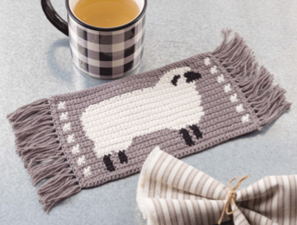crochet mug rug with a sheep on it