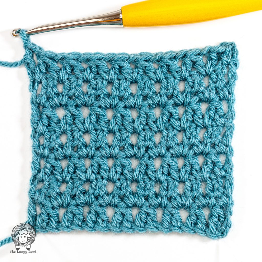 completed paired double crochet stitch tutorial swatch with a yellow crochet hook
