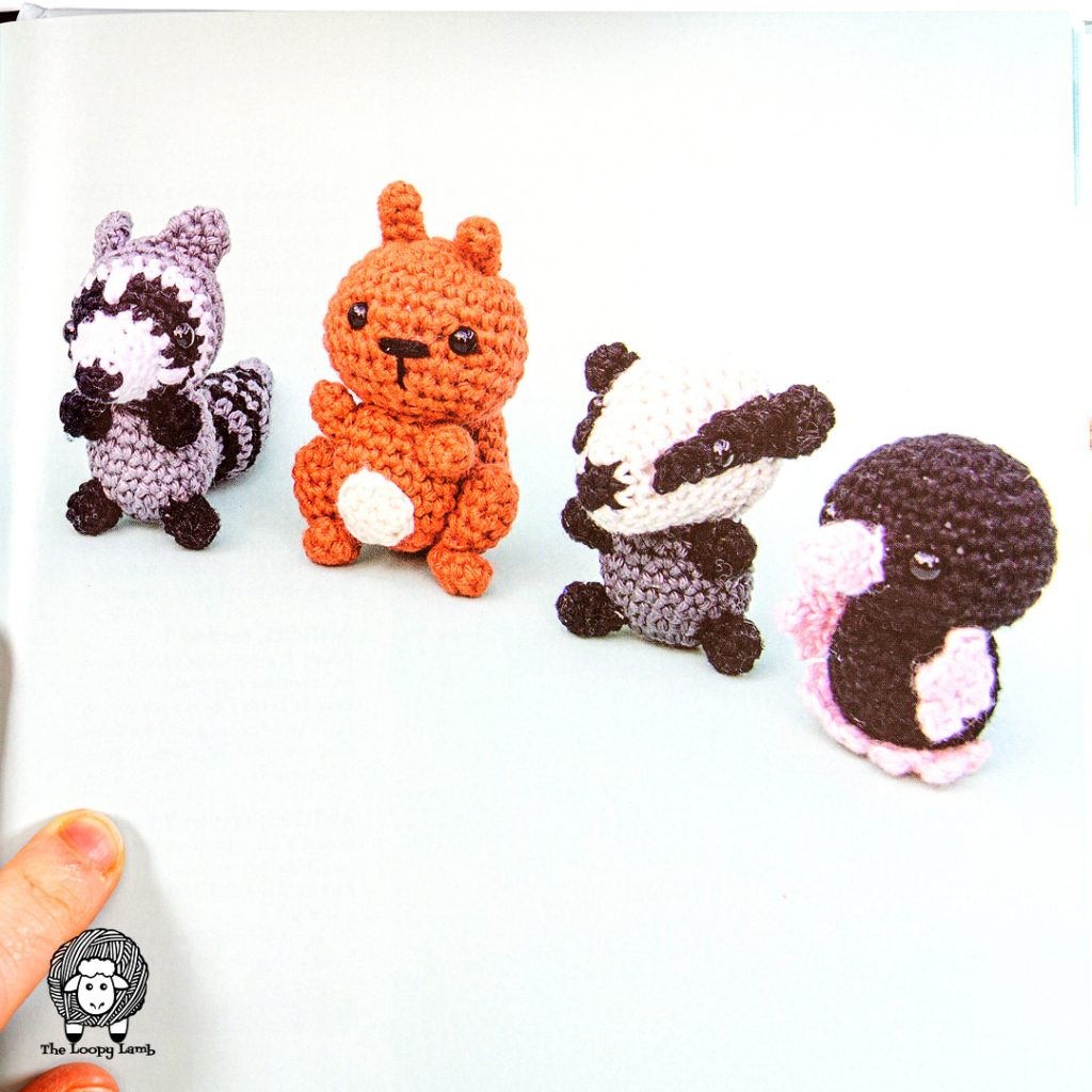 4 tiny crochet animals from the book being reviewed