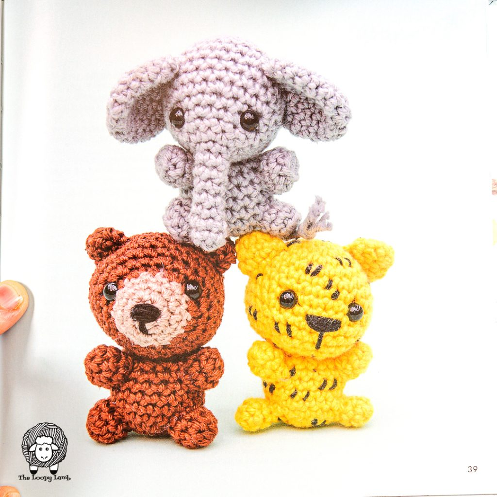three crochet animals stacked in a pyramid