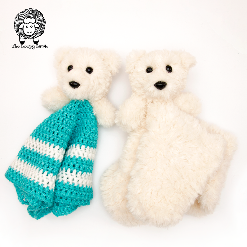 two amigurumi bears turned into lovey toys in a flat lay next to eachother.
