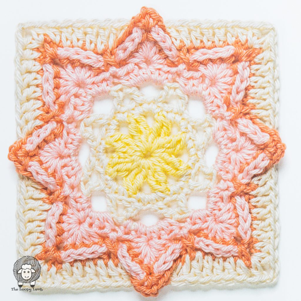 flowery crochet square in white, pink, red and yellow