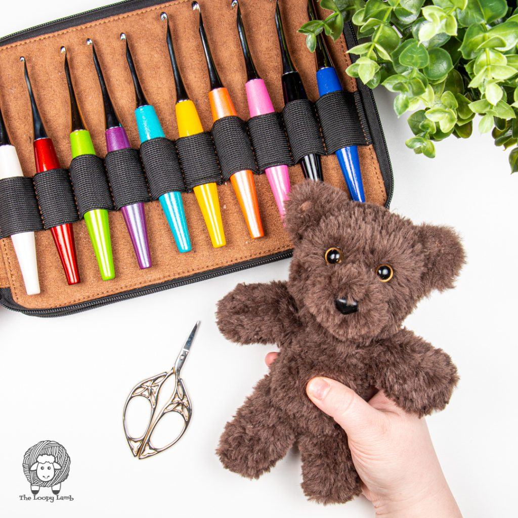 hand holding a faux fur teddy bear made with this free crochet teddy bear pattern