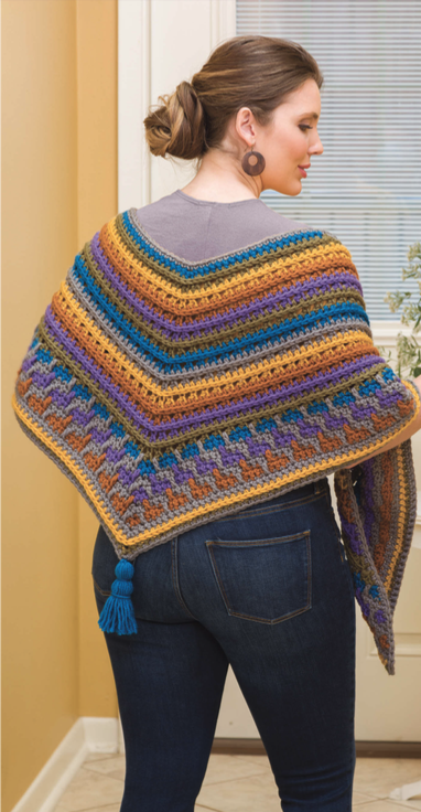 Woman modelling the Monet Crochet Shawl by Lena Skvagerson