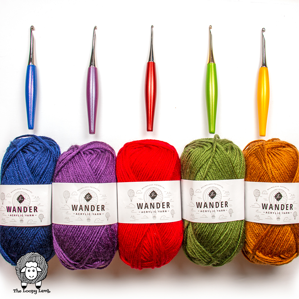 Furls Wander Yarn in five different colours with matching furls odyssey hooks on top of them