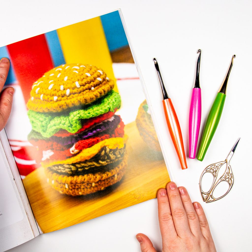 crochet hamburger scarf from the new stephanie pokorny book next to some furls odyssey hooks