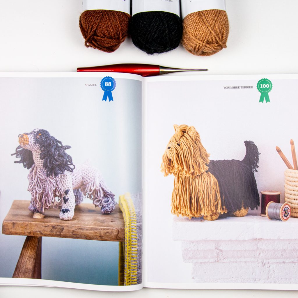 two different dogs from Crocheted Dogs by Vanessa Mooncie: a spaniel and yorkshire terrier