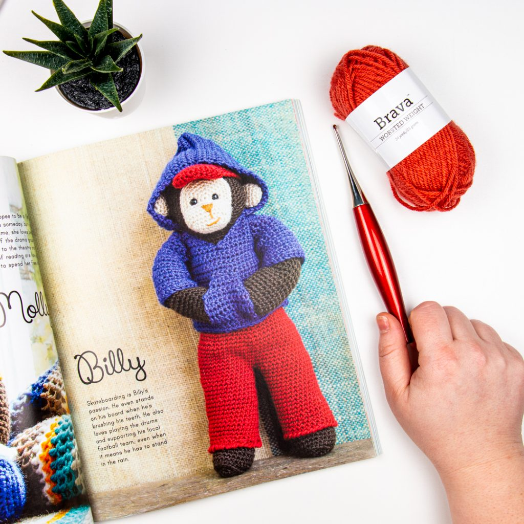 Amigurumi monkey wearing clothes in an image from the book being reviewed.