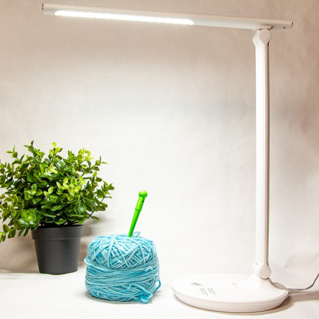 Illuminated crafting lamp, lighting up a plant and ball of yarn