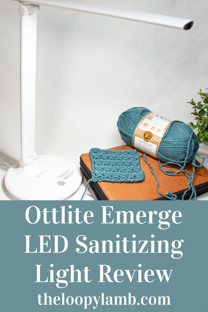 Ottlite Emerge LED Sanitizing Desk Lamp illuminating a crochet swatch and ball of yarn.