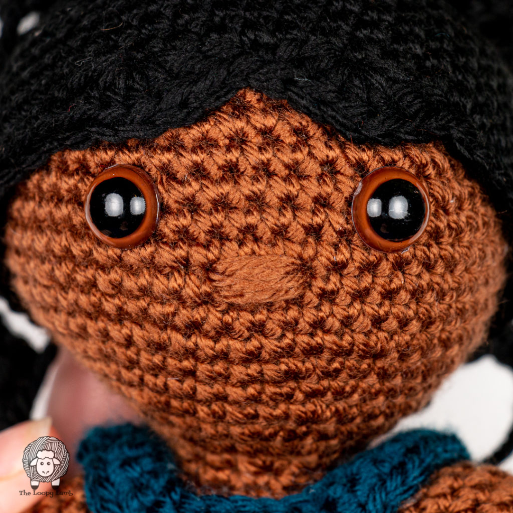 close up image of the amigurumi doll face