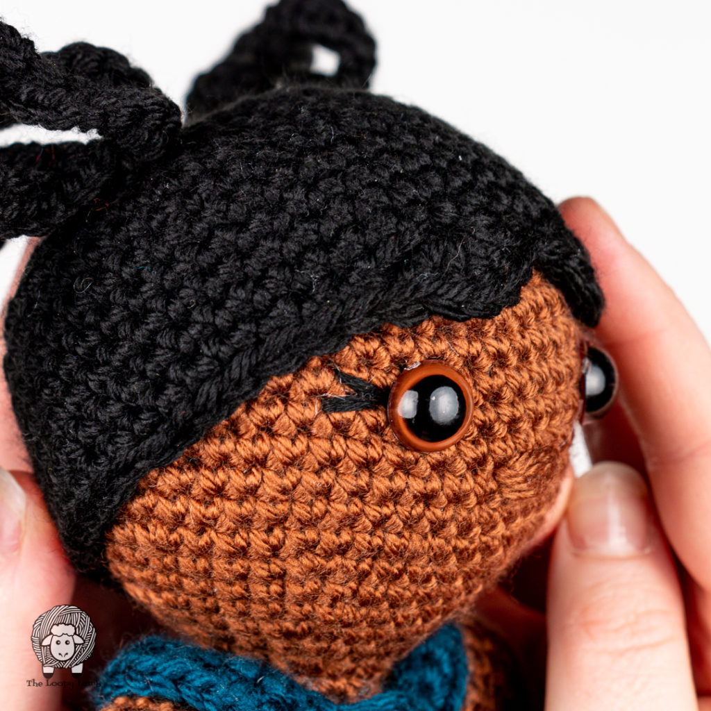 completed embroidered eyelashes uses in this easy crochet doll pattern found free on this blog