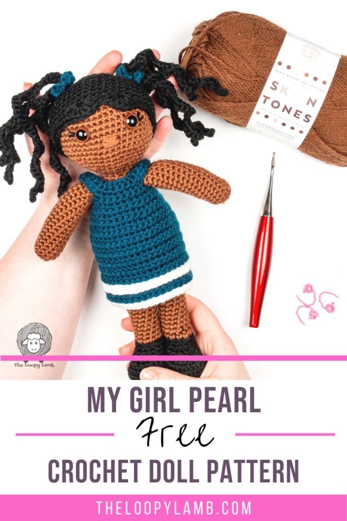 amigurumi doll made with this easy crochet doll pattern in a flat lay with text overlay indicating this is a free crochet pattern