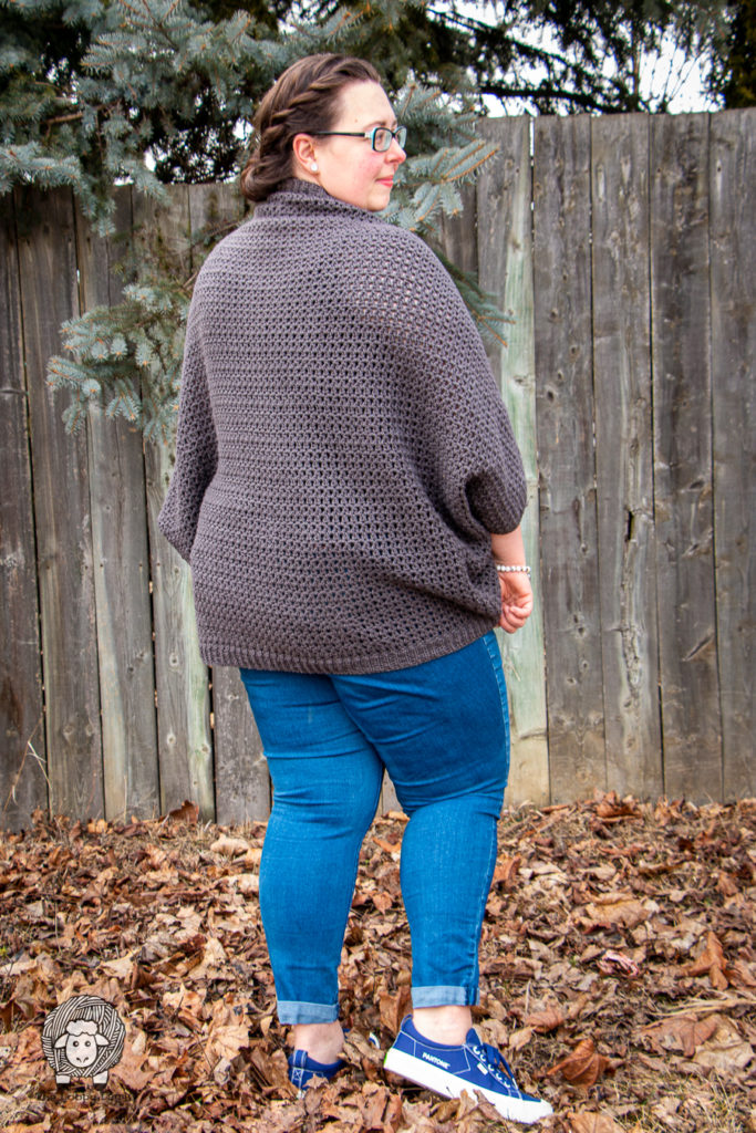 Woman modelling a crochet cardigan made with this free crochet cocoon cardigan pattern