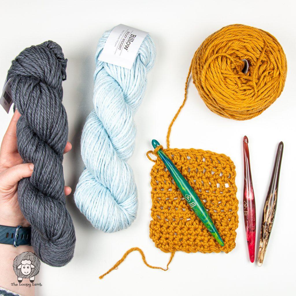 bulky pima cotton yarn in a flat lay with furls streamline swirl crochet hooks