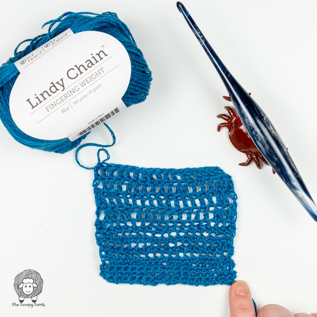 Lindy Chain in a crochet swatch next to a furls streamline crochet hook