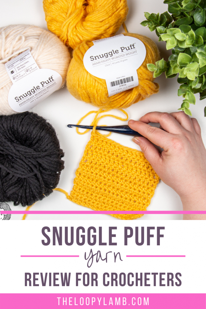 Snuggle Puff Yarn in a flat lay with crochet hooks and text overlay indicating a review of this yarn