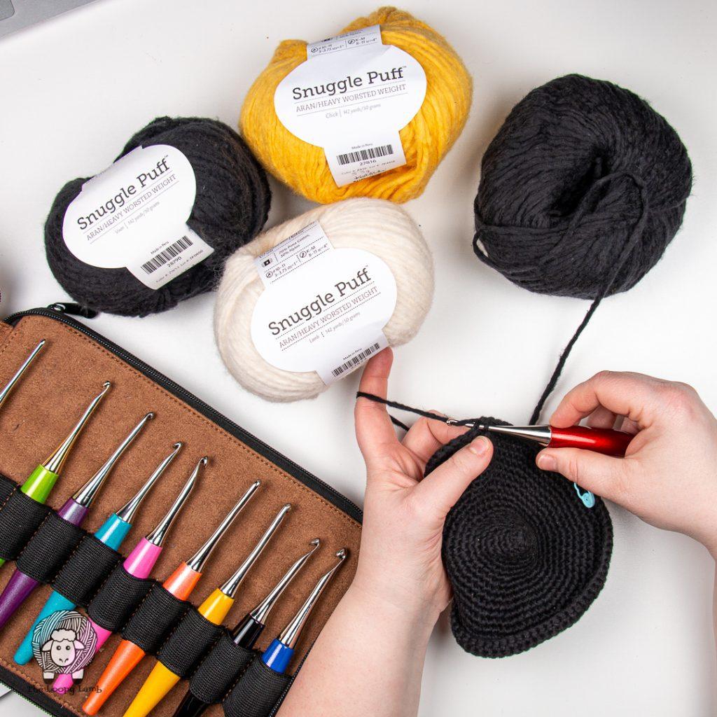 cotton blend yarn in a flat lay with furls odyssey crochet hooks
