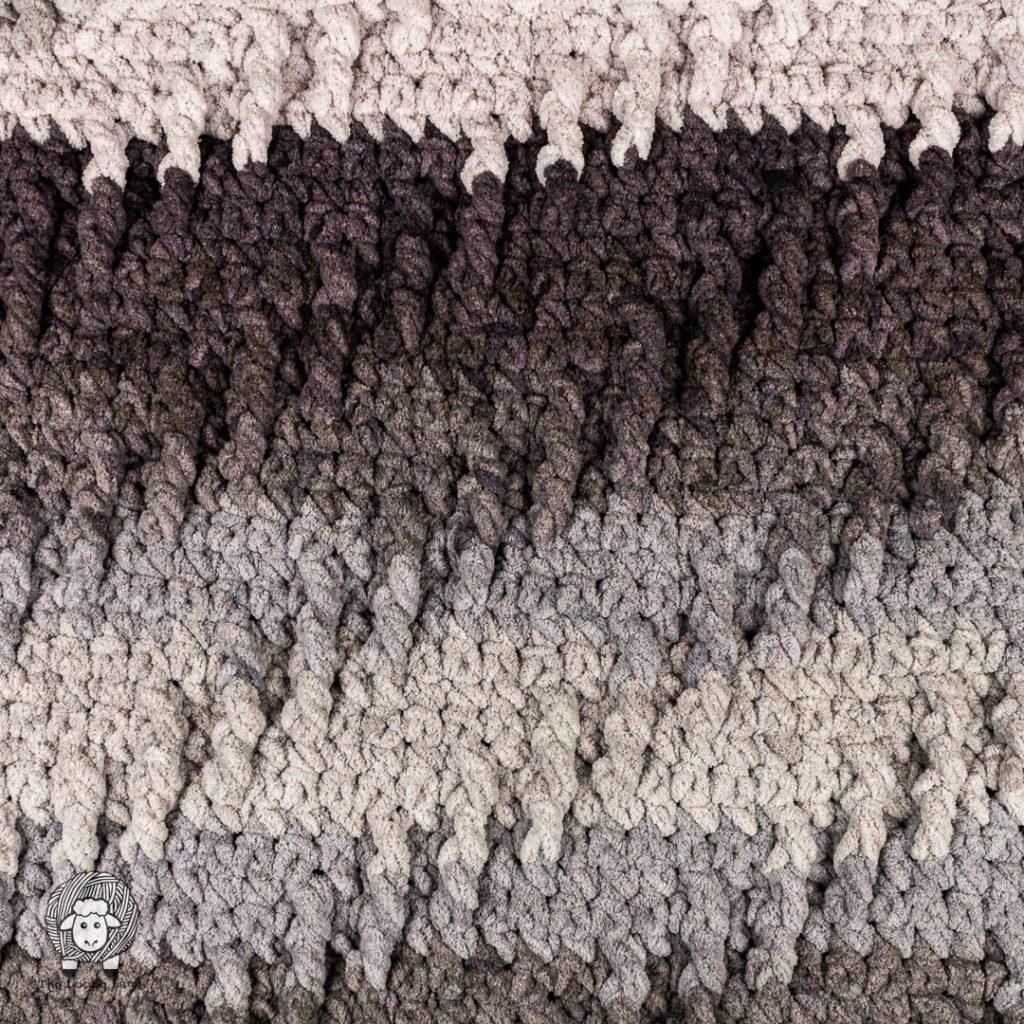 Colour of benat blanket ombre colour transition in a crochet blanket.