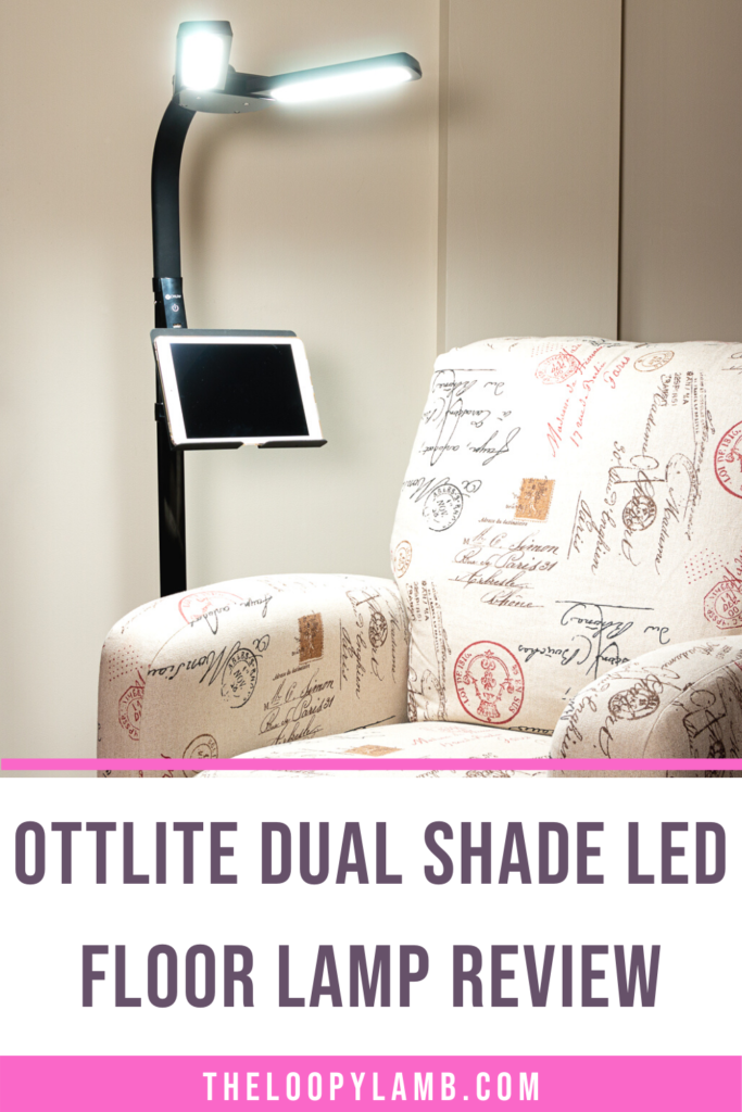 Illuminated OttLite Dual Shade LED Floor Lamp next to a recliner, text indicating a review