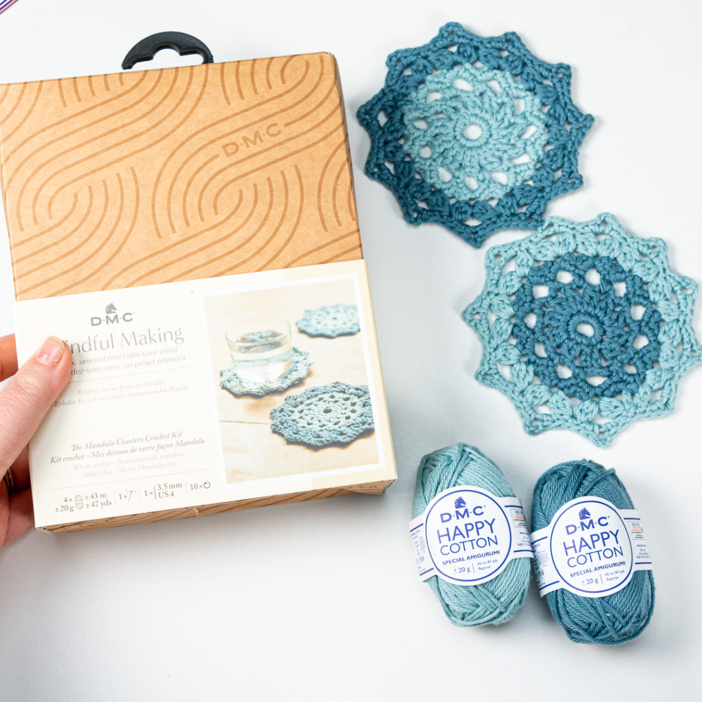 DMC Mindful Making Kit and two completed crochet mandala coasters from the kit