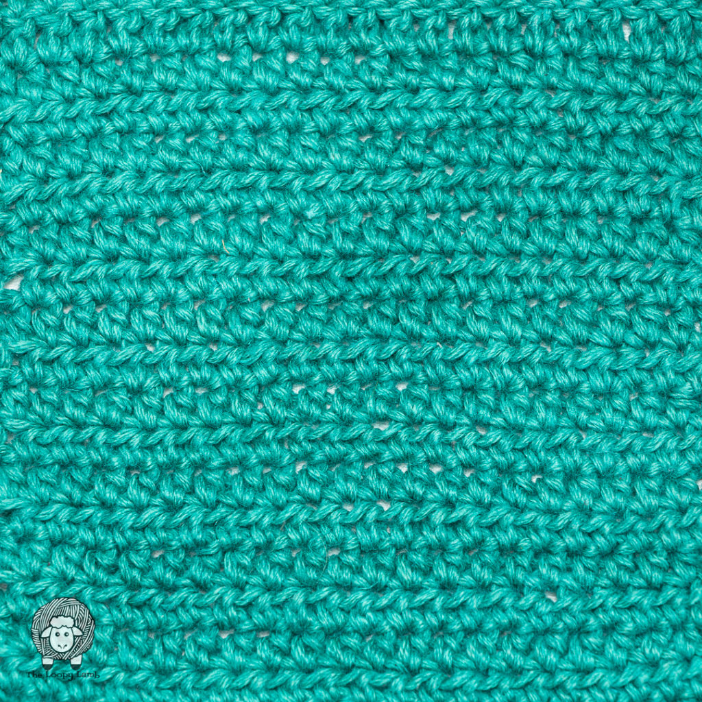 Close up image of half double crochet stitches in a swatch made of Kelbourne Woolens Mojave yarn