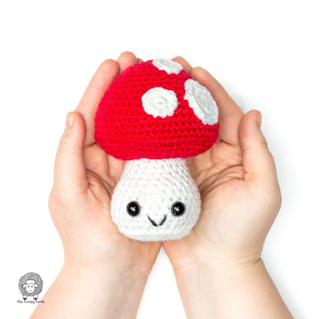 hands holding an amigurumi mushroom made with this free crochet mushroom pattern
