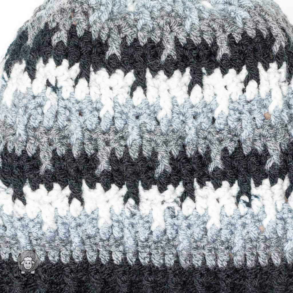 close up texture of the crochet hat for men and women