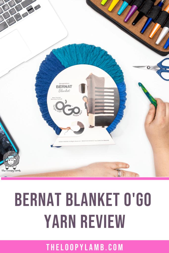 Bernat Blanket O'Go Yarn in a flat lay, text reads Bernat Blanket O'Go Yarn Review