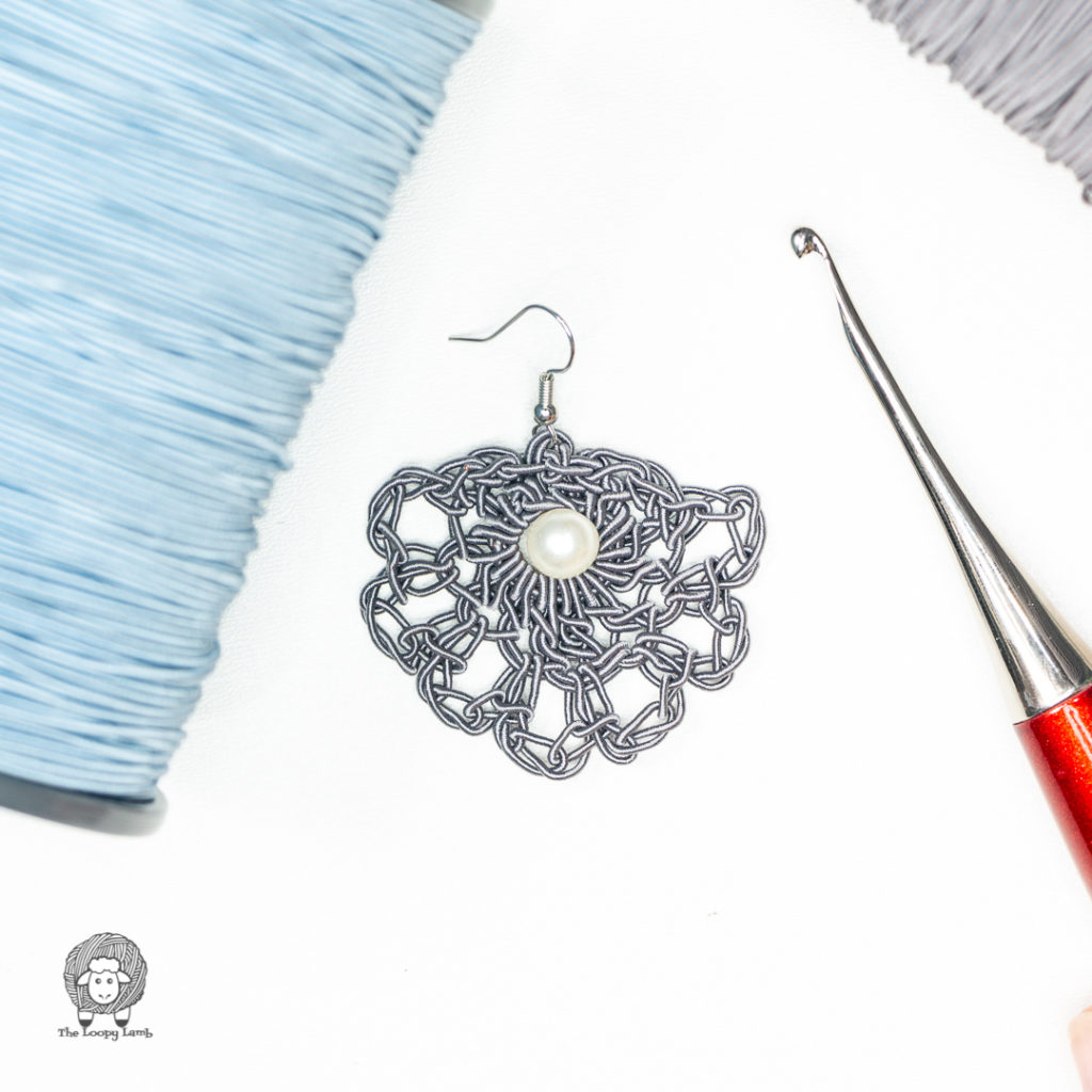 crochet earring made with DMC Memory Thread Cones.