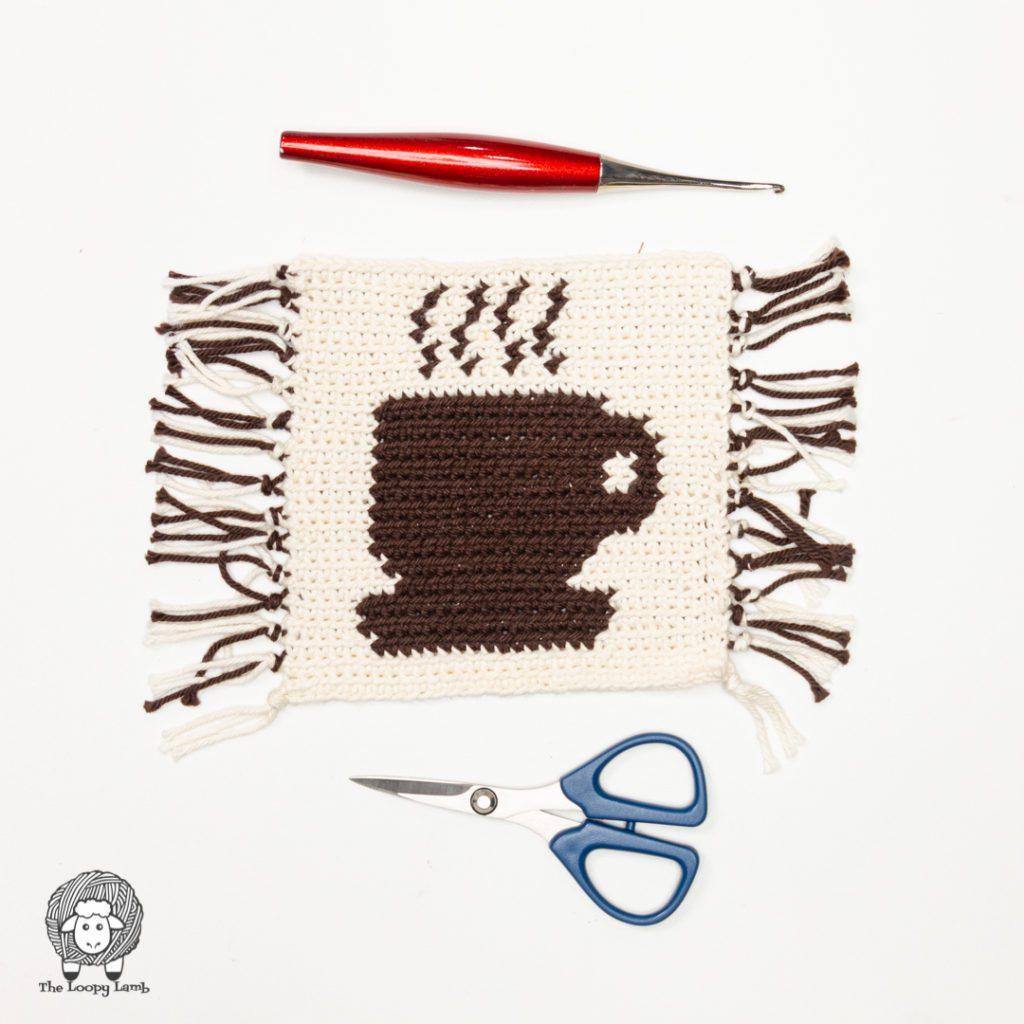 coffee cup mug rug made with this free crochet mug rug pattern