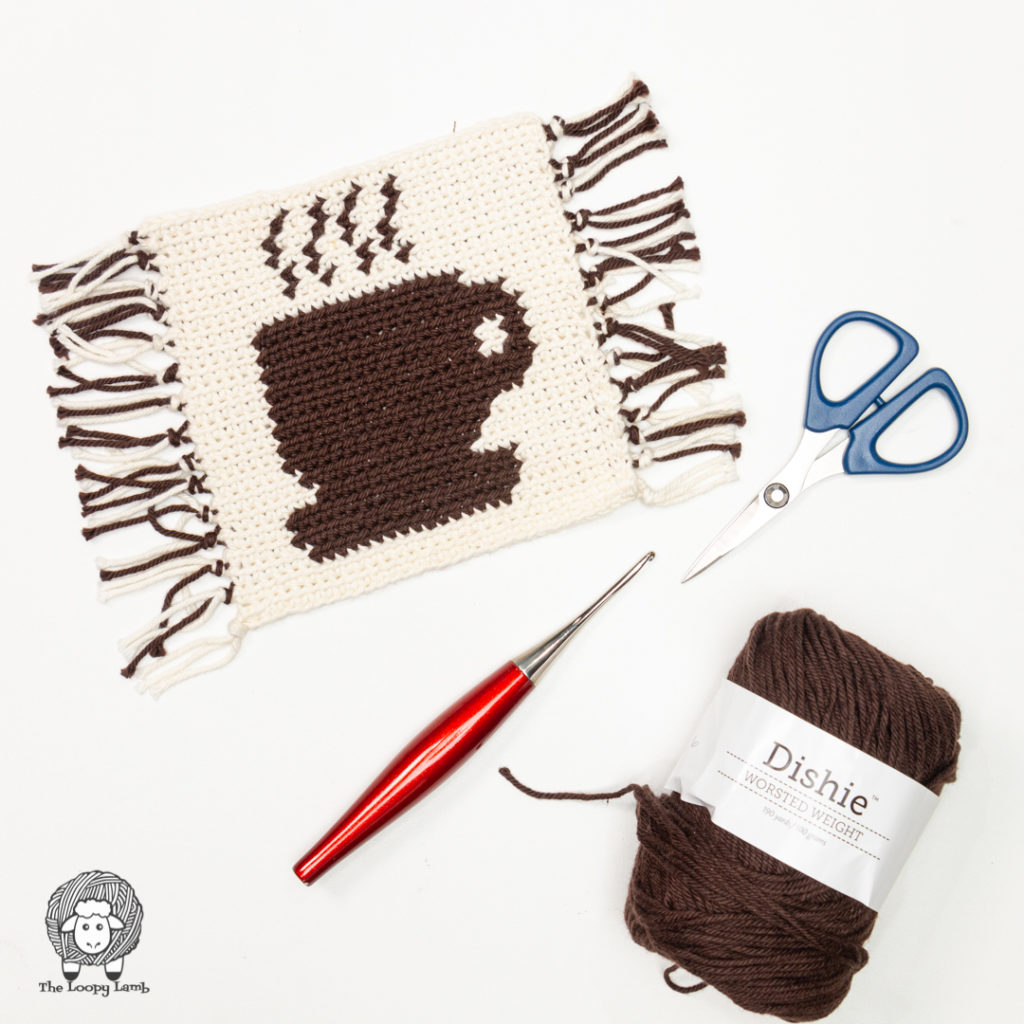 crochet coaster with coffee cup image on it