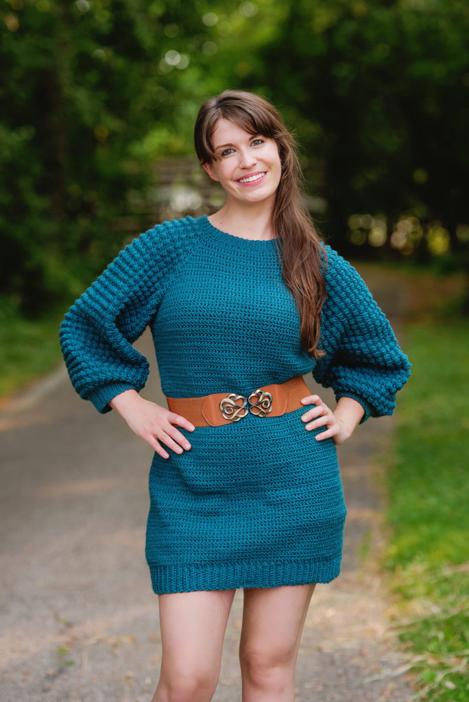 woman modelling a teal crochet sweater dress from the Crochet Foundry Fall 2021 edition