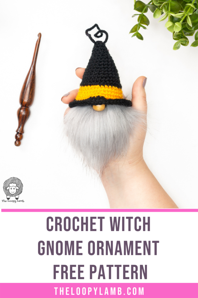 crochet witch gnome ornament held in a hand
