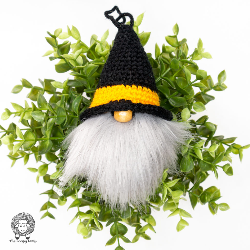 crochet witch gnome on a plant