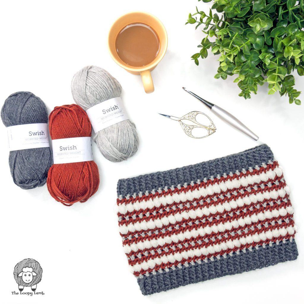 Crochet cowl in a flat lay with WeCrochet Swish Worsted Weight Yarn#wecrochetofficial #wecrochet #stitchandhustle #2021StitchAndHustleBlogHop