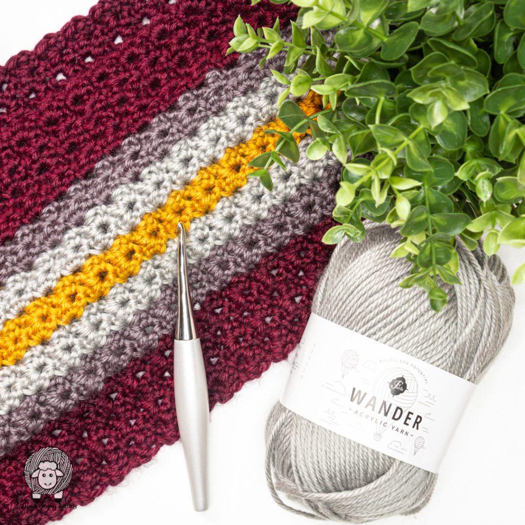 Furls Wander yarn and Odyssey hook in a flat lay