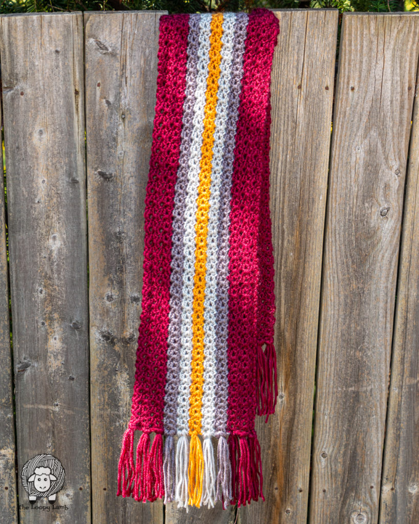 gender-neutral scarf hanging on a fence