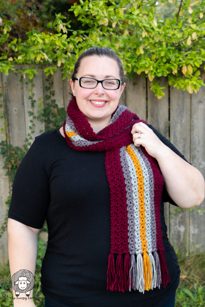 smiling woman modelling a crochet scarf