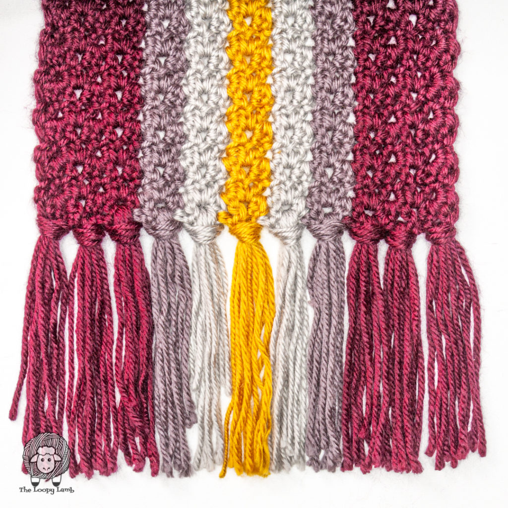 close up of the tassels on the Brave at Heart Crochet Scarf
