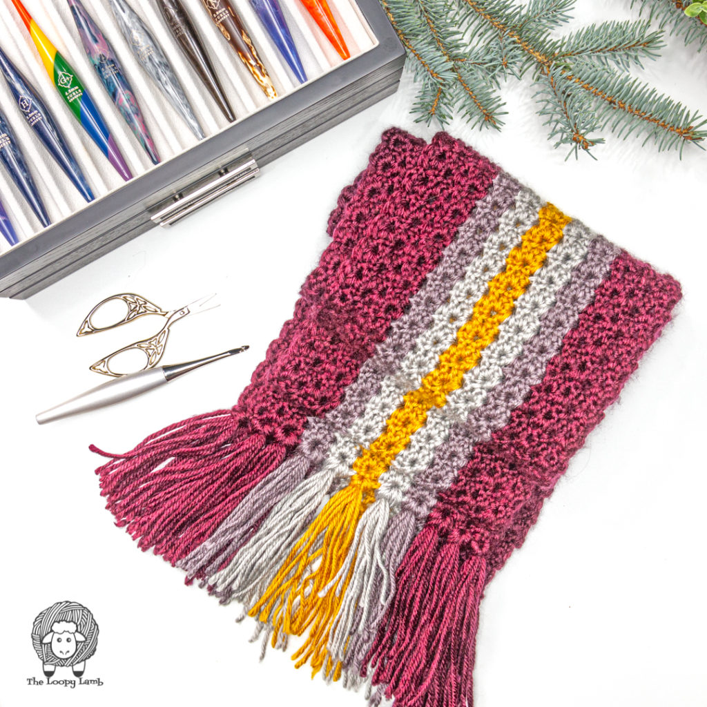 textured crochet scarf in a flat lay with a furls odyssey crochet hook