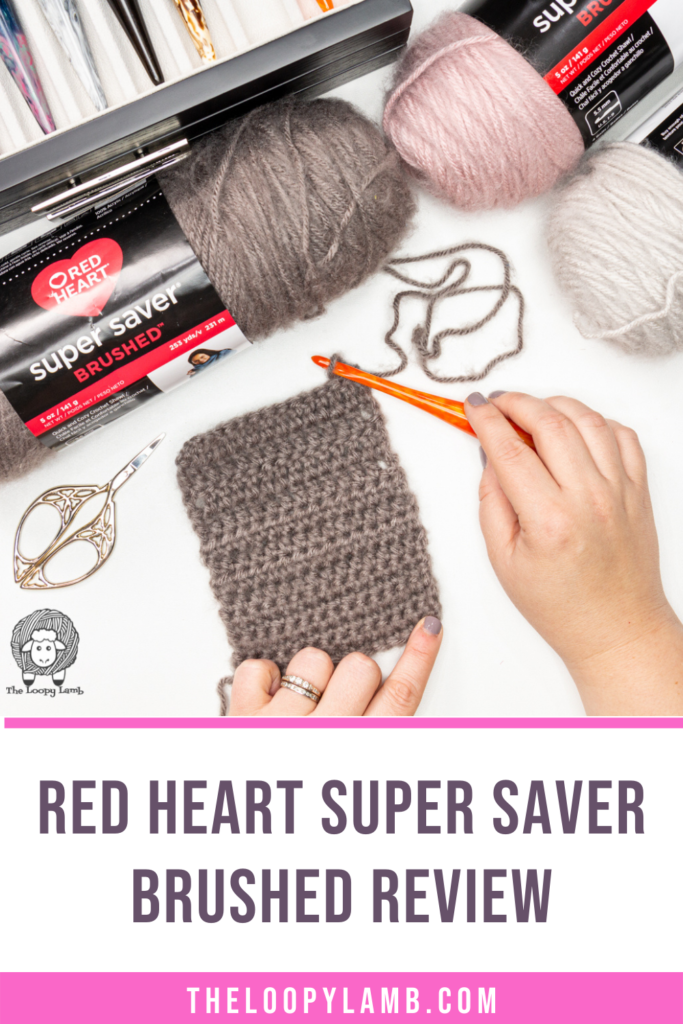 three different colours of Red Heart Super Saver Brushed yarn in a flat lay, text indicates a yarn review