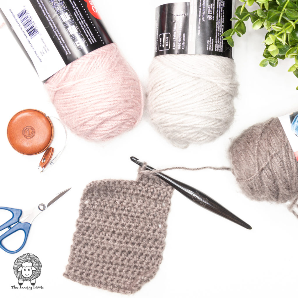 brushed acrylic yarn in a flat lay with a crochet swatch