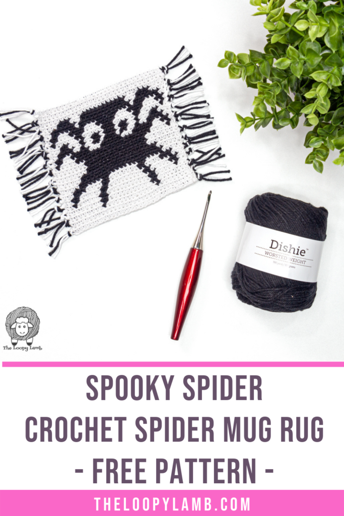 crochet spider mug rug made with this free pattern in a flat lay with crochet hook and yarn.